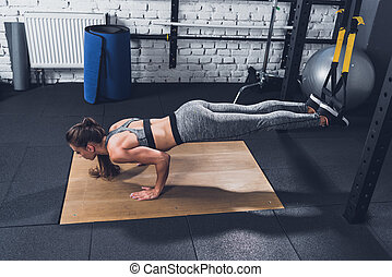 woman doing TRX Suspension Training