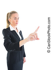 Side view of attractive young businesswoman pointing