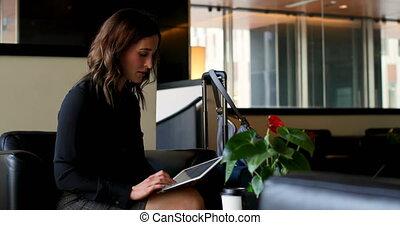 Side view of beautiful caucasian businesswoman using digital...