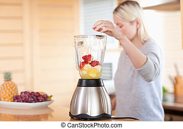 Side view of blender getting filled