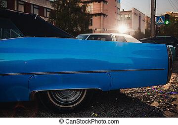 side view of blue vintage retro car
