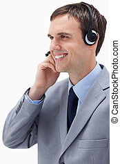 Side view of businessman using headset