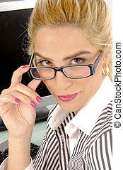 side view of businesswoman holding eye wear in an office