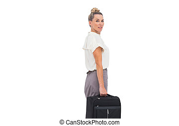Side view of businesswoman with briefcase