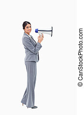 Side view of businesswoman with megaphone
