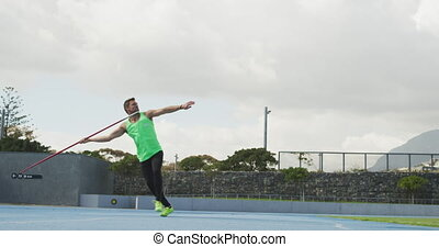 Side view of caucasian athlete throwing javelin - Side view ...