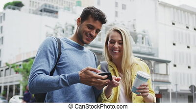 Side view of Caucasian couple on the go using phone during coronavirus pandemic