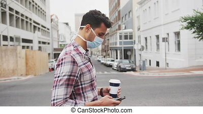 Side view of Caucasian man on the go wearing a coronavirus ...