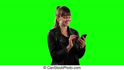 Side view of Caucasian woman using her phone with green screen