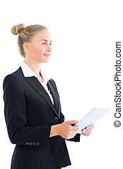 Side view of cheerful young businesswoman holding her tablet