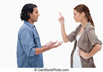 Side view of couple in a tensed conversation