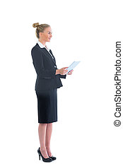 Side view of cute blonde businesswoman working with her tablet