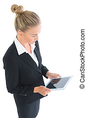 Side view of cute businesswoman working with her tablet