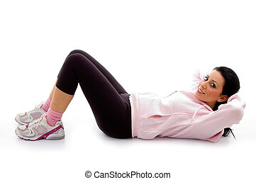 side view of exercising female on white background