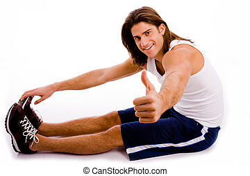 side view of exercising man with thumbs up