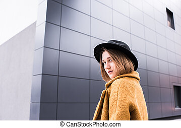 fashionable young woman in hat
