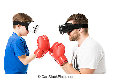 side view of father and son boxing in virtual reality headsets isolated on white