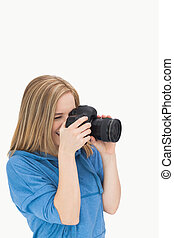 Side view of female photographer with photographic camera