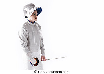 side view of fencer in uniform holding rapier in hand on white