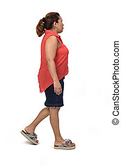 side view of full portrait of a woman with skirt walking on white background,look side
