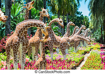 Side view of giraffes statues
