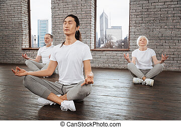 Side view of group while yoga training