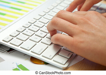 Side view of hands typing