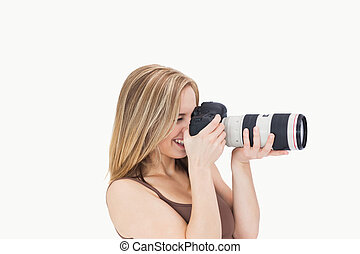 Side view of happy photographer with photographic camera