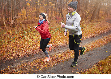 Side view of jogging senior couple