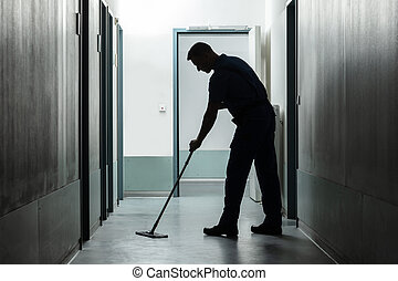 Man Cleaning Floor With Mop