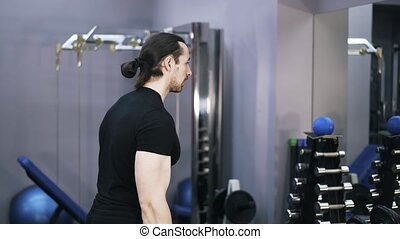Side view of man doing a barbell exercise