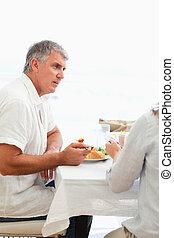 Side view of man having dinner