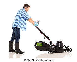 man pushing lawnmower - side view of man pushing lawnmower