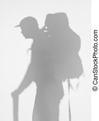 side view of man with backpacker, silhouette
