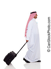 middle eastern business traveller - side view of middle...