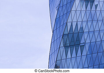 Side view of modern glass skyscrapers with reflection