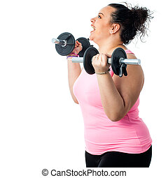 Side view of obese girl doing workout.