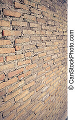 Side view of old orange vintage brick wall