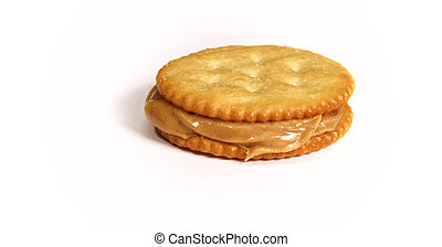 side view of peanut butter and cracker sandwich on white background