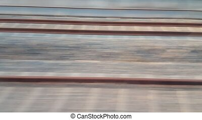 Side view of railway from fast train in city from high angle view