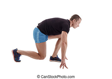 Side view of runner on starting block