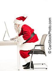 Santa Claus using computer