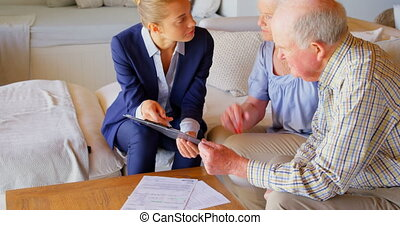 Side view of senior Caucasian couple meeting with real estate agent in a comfortable home 4k