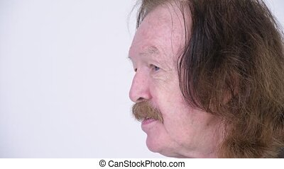 Side view of senior man with mustache talking - Studio shot...