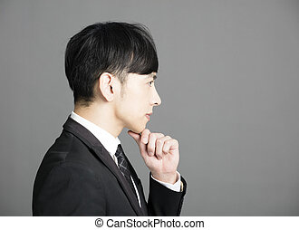 Side view of serious young businessman