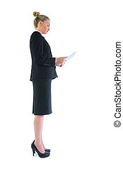 Side view of smart attractive businesswoman using her tablet