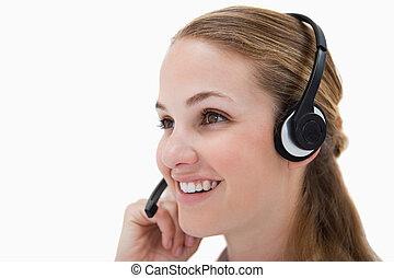 Side view of smiling call center agent