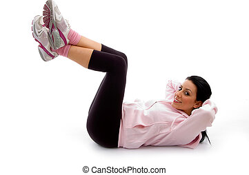 side view of smiling exercising female on white background