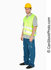 Side view of smiling young construction worker