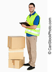 Side view of smiling young delivery man